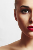 beautiful woman with red lips.close-up.half face.unusual