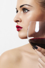 Beautiful woman drinking red wine.red lips.wineglass