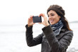 Woman taking photo with smartphone