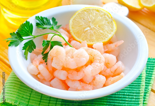 boiled shrimps in the white bowl on the table