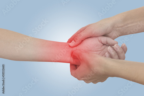 Acute pain in a woman wrist. Female holding hand to spot of wris