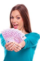 Happy brunette with money
