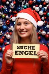 Hübsche Blondine mit Nikolausmütze