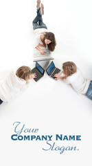 Aerial view of three girls with computer