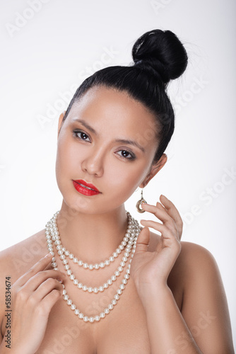 Portrait of young asian girl in fashion style