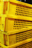 yellowl plastic - stacked packing containers.