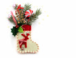Christmas decorations and sock on white background