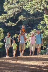 3 generation family walking in woods