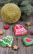 Gingerbread cookies and Christmas decoration over wooden table