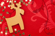 Red Christmas Background with Handmade Reindeer, Golden Stars an