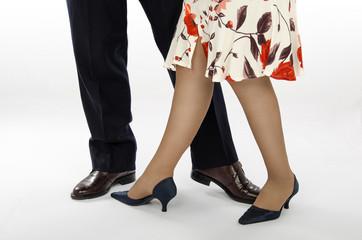 Their feet in dance position
