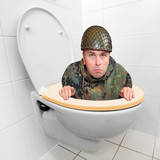 Cowardly soldier hiding in the toilet bowl.