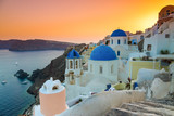 Sunset over the churches of Oia village, Santorini, Greece