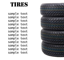Stack of four wheel new black tyres for winter car driving isola