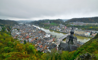 Top view of the city of Dinant with church on a cloudy day. Seen