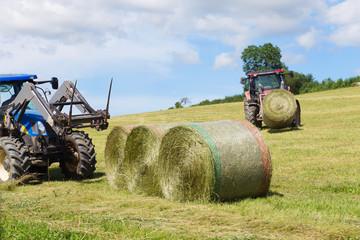Harvesting rolls hay