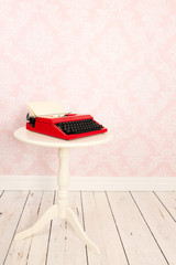 Vintage wall and wooden floor with old typewriter