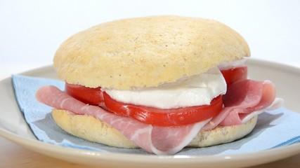 sandwich with ham, mozzarella and tomato