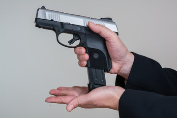 Woman loading a hand gun