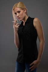 Standing Portrait of Real Young Blond Female Smoking Cigarette