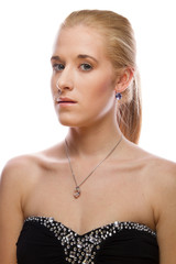 Beauty Close up Portrait of Young Blond Female with Jewelry