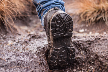 Sole of an Hiking shoe covered in mud