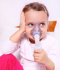 Little girl making aerosol treatment for lung diseases
