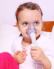 Little girl making aerosol treatment