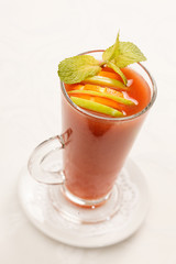 drink with with slice of orange and apple in glass
