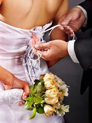 Bridal trying on wedding dress.