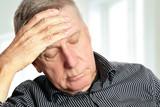 Senior man with a headache