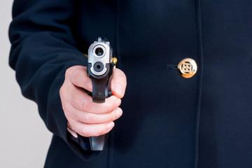 Woman pointing a hand gun