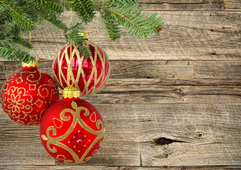 Three Red Christmas Balls Hanging on Wooden Background