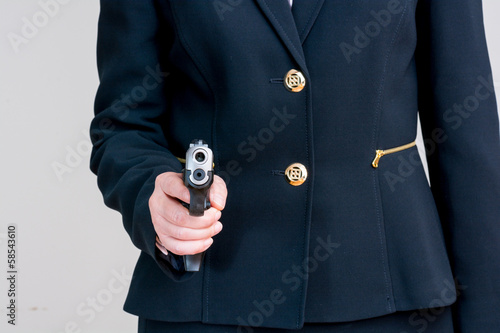 Woman pointing a hand gun
