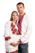 Young couple in Ukrainian style clothing over white
