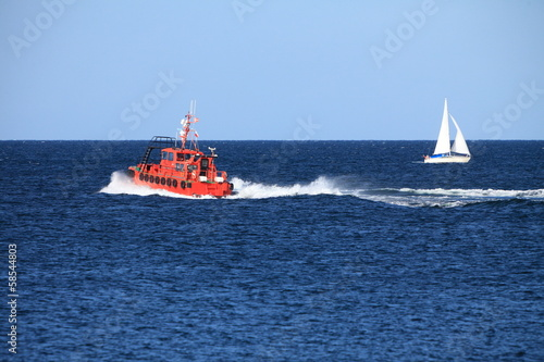 pilot boat orange tugboat at the sea