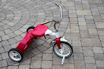 Childs Red Tricycle Parked