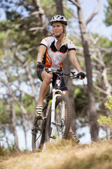 Woman on mountain bike in woods