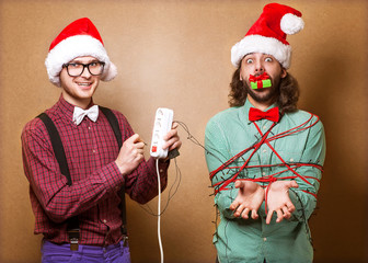 two guys to play with Christmas garland
