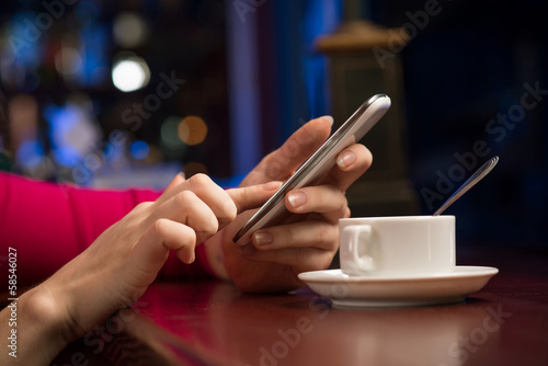 close-up of female hands holding a cell phone