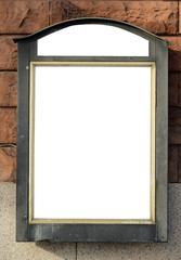 Empty billboard on brick wall