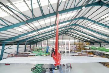Passenger jet inside hangar