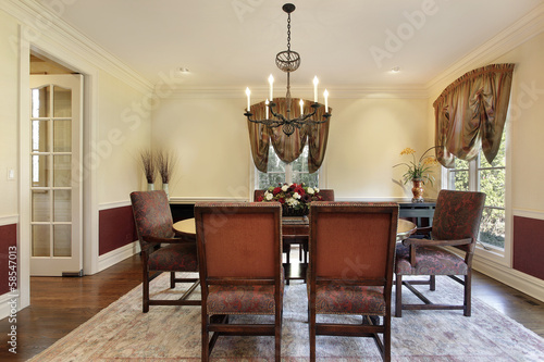Dining room with cream colored walls