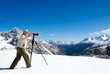 Happy photographer in snow mountains