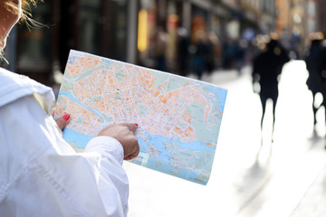 Tourist looking at City map