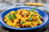 couscous salad with curry, cranberries and herbs