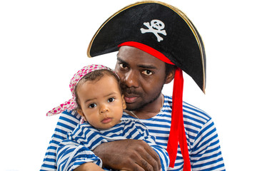 African american child boy and father in costume pirate