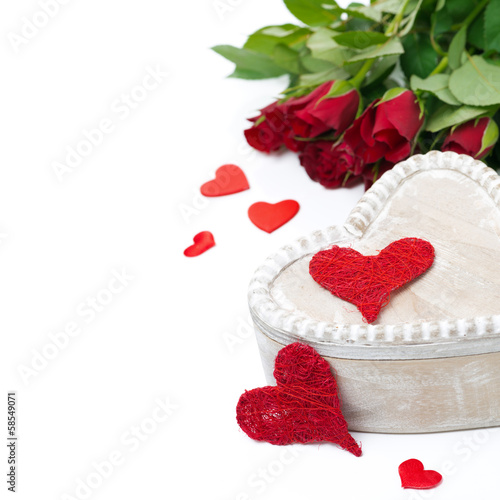 wooden box, red hearts and roses for Valentine's Day