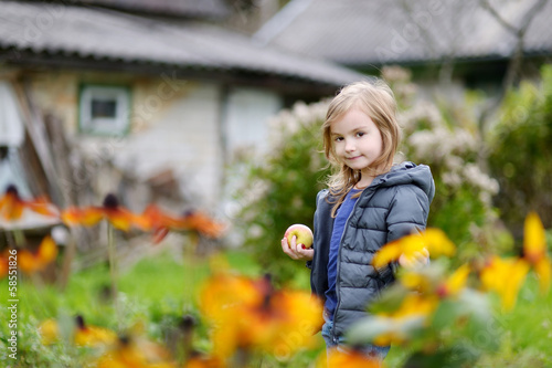 Little girl's portrait outside on an autumn day