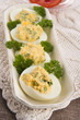 Stuffed eggs with parsley and mayonnaise